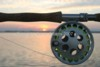 rod and reel with sunset background